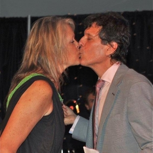 25. Host and hostess Jonathan Brielle and Cherie King share a kiss