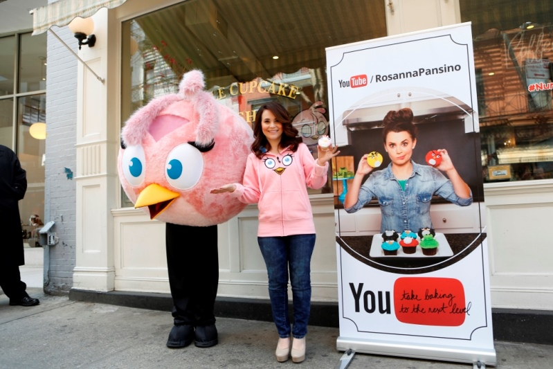 Rosanna Pansino and Stella outside the Little Cupcake Bake Shop next to the Youtube Shop at the Angry Birds Yotube Event