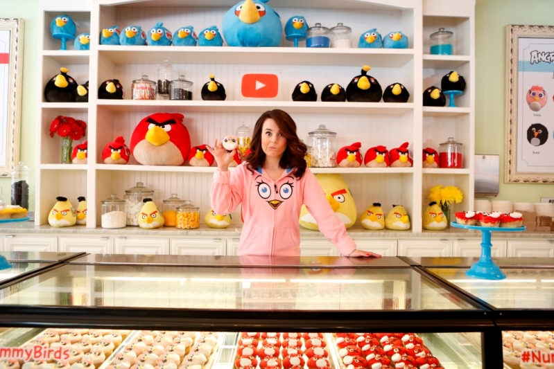 Rosanna Pansino holding a cupcake at Little Cupcake BakeShop Angry Birds Youtube Event